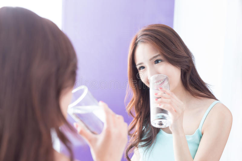 Young woman drink water stock images