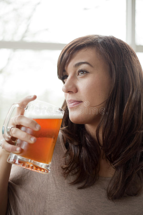 Download Young Woman Drinking Beer stock photo. Image of pilsner - 28359352