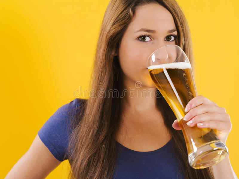 Young woman drinking beer stock photography