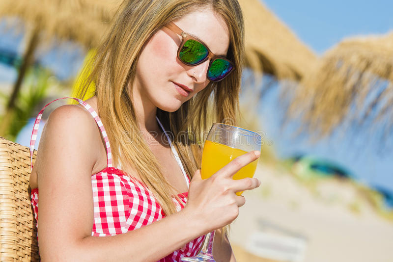 Young woman drinking a cocktail royalty free stock photo