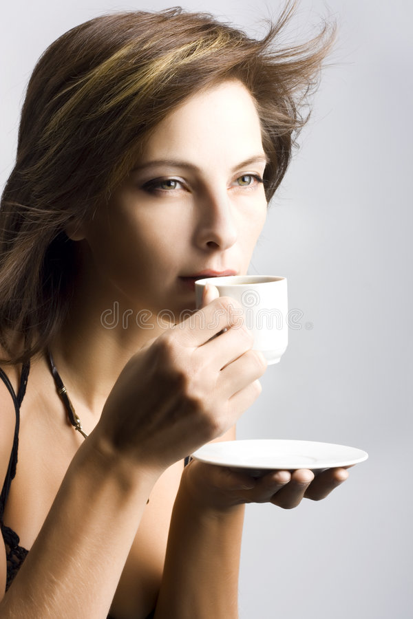 Download Young Woman Drinking Coffee Royalty Free Stock Image - Image: 7375846