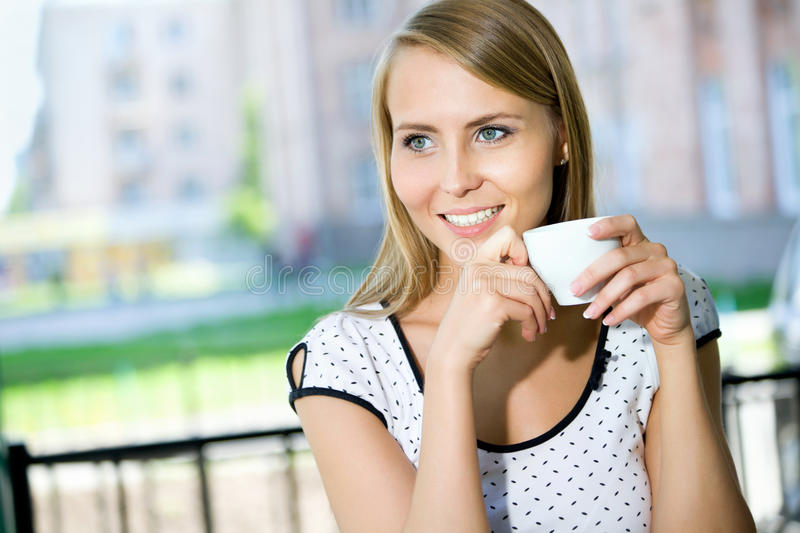 Young woman drinking coffee stock image