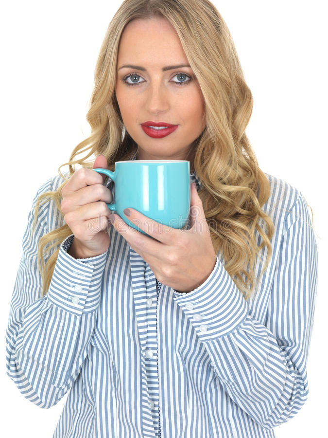 Young Woman Drinking Coffee from a Blue Mug stock image