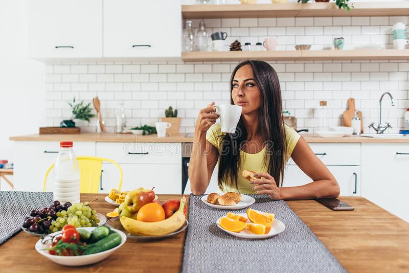 Young woman drinking coffee at home in the morning. Young woman drinking coffee at home in the morning stock photography