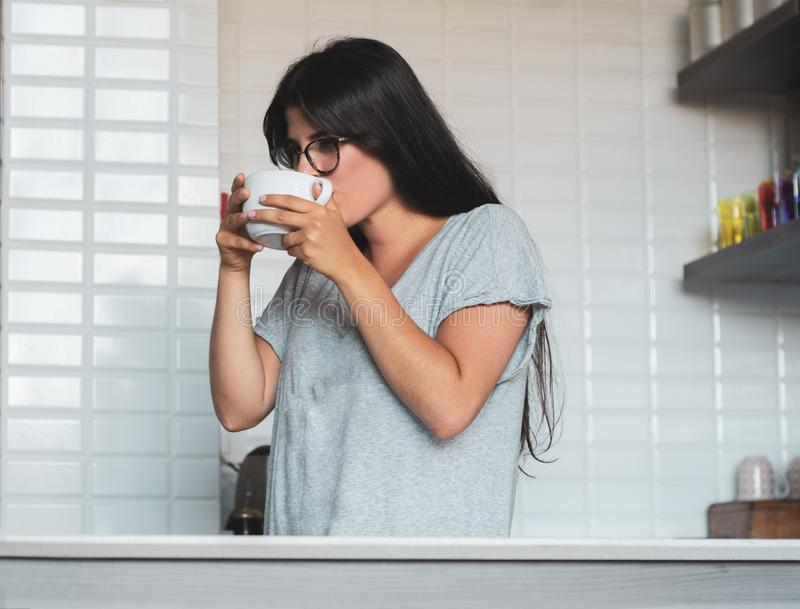Young woman drinking coffee at home stock images