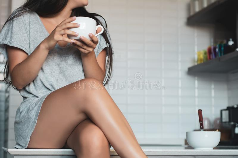 Young woman drinking coffee at home stock photos