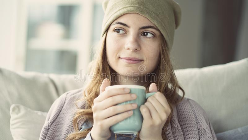 Young woman drinking coffee at home. Young woman drinking coffee at  home royalty free stock photo