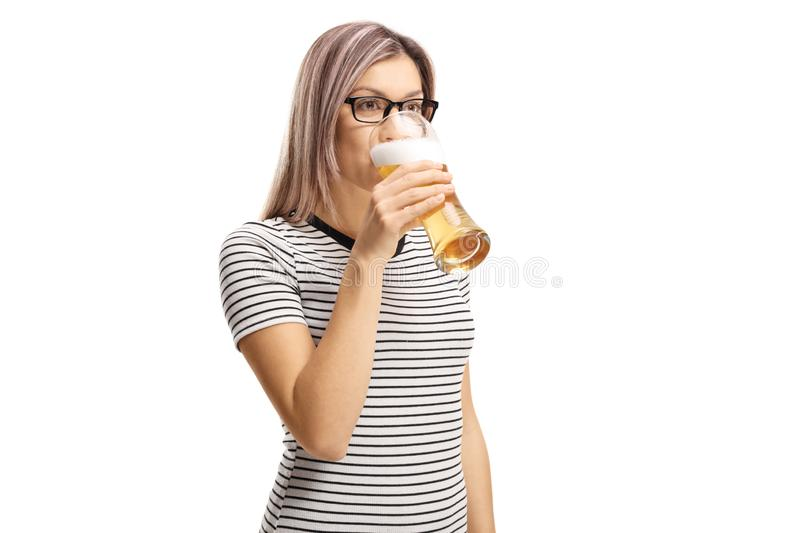 Young woman drinking a glass of beer royalty free stock photo