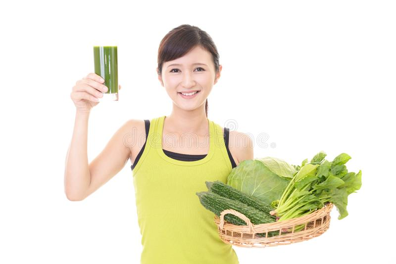 Woman with a glass of vegetable juice. Young woman drinking a glass of vegetable juice stock photo