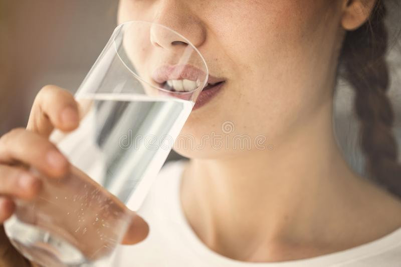 Young woman drinking glass of water close up view royalty free stock photos