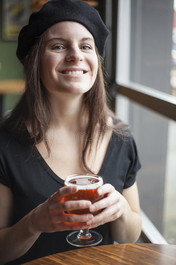 Young Woman Drinking Inda Pale Ale royalty free stock photos