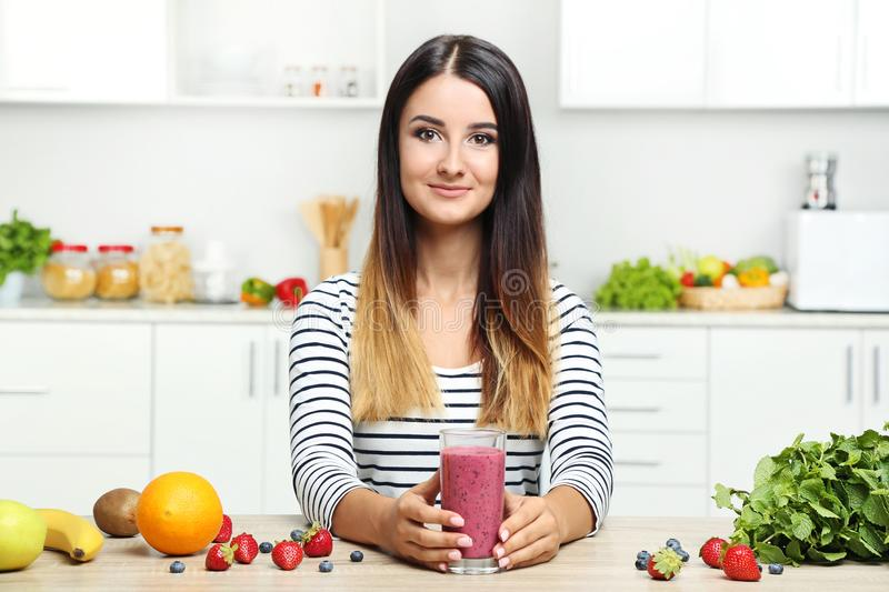 Young woman drinking smoothie stock image