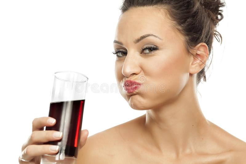 Woman drinking soda stock images