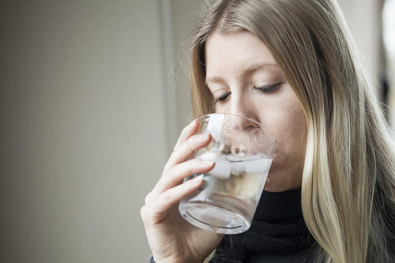 Young Woman Drinking Water stock photography
