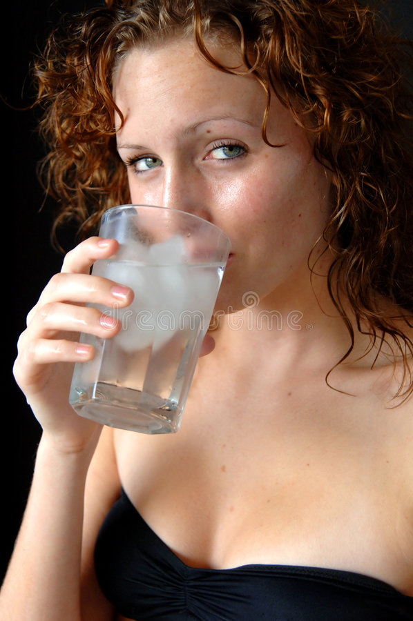Download Young woman drinking water stock photo. Image of cute - 4666480