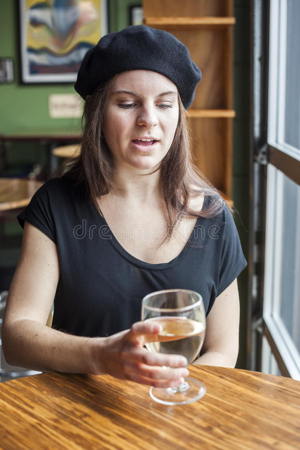 Young Woman Drinking White Wine Stock Images