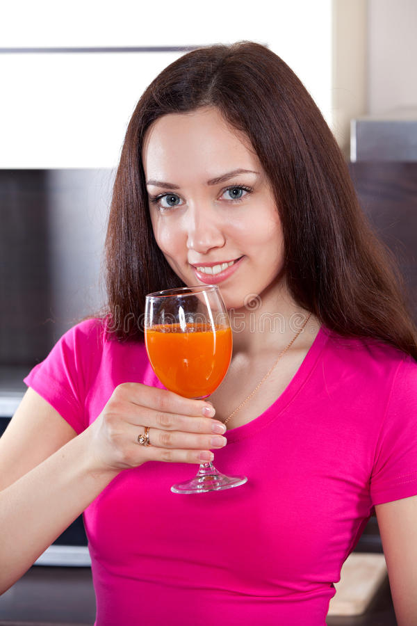 Young woman drinks fresh juice royalty free stock image