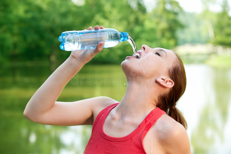Download Young woman drinks a water stock image. Image of carefree - 18356207
