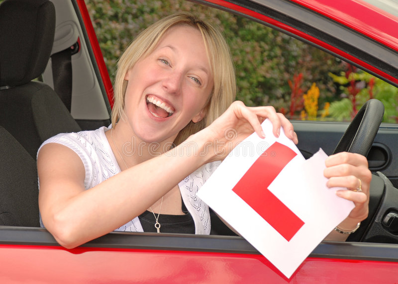 Young woman driver. Young woman delighted having just passed her driving test royalty free stock photos