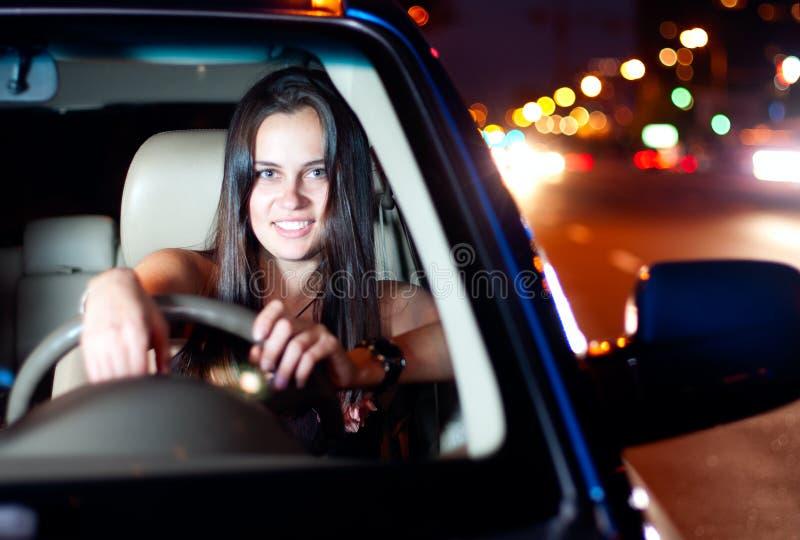 Young woman driving car stock photos