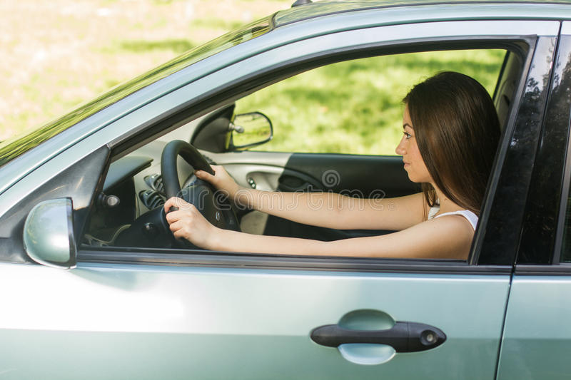 Young woman driving car royalty free stock images