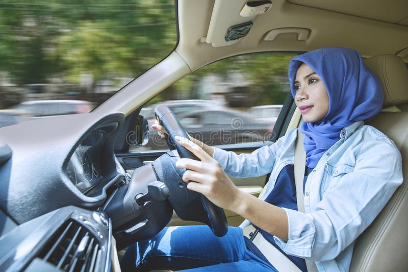 Young woman driving for travel on vacation royalty free stock photography