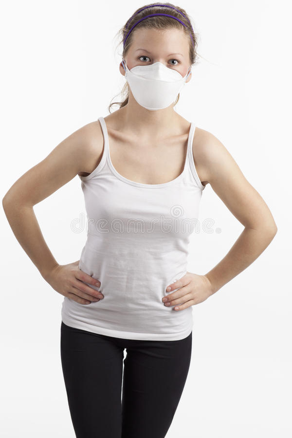 Young woman with dust mask. Sporty young woman with sport clothes is wearing a dusk mask royalty free stock photos