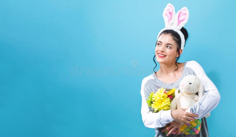 Young woman with an Easter bunny royalty free stock image