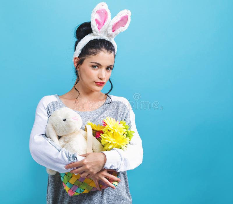 Young woman with an Easter bunny stock image