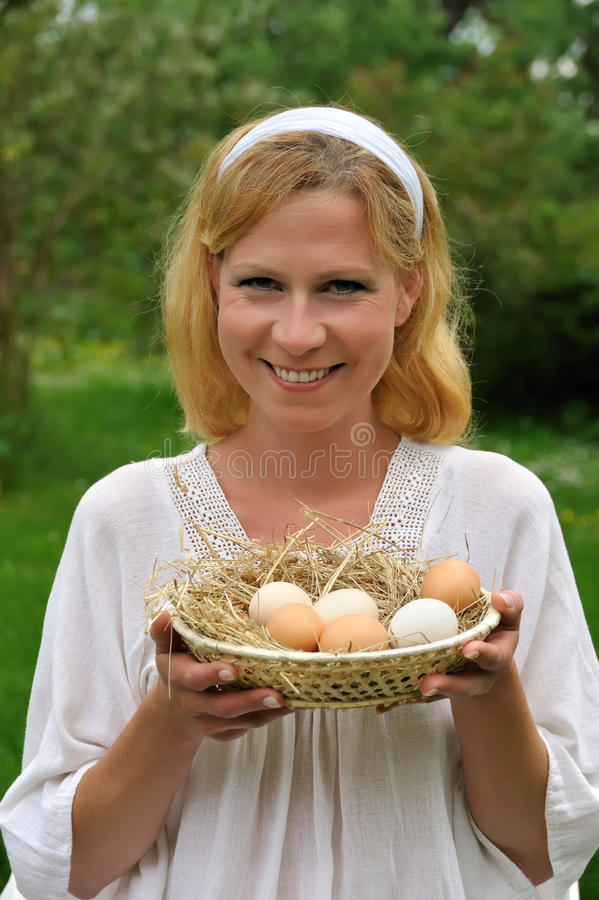 Young woman and Easter eggs stock images