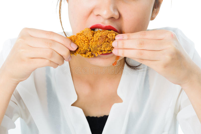 Young woman eat fried chicken royalty free stock photography