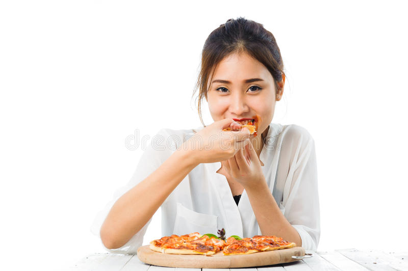 Young woman eat pizza royalty free stock image