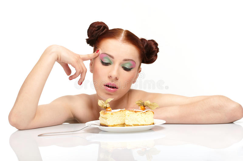 Young woman eat tasty cake stock photo