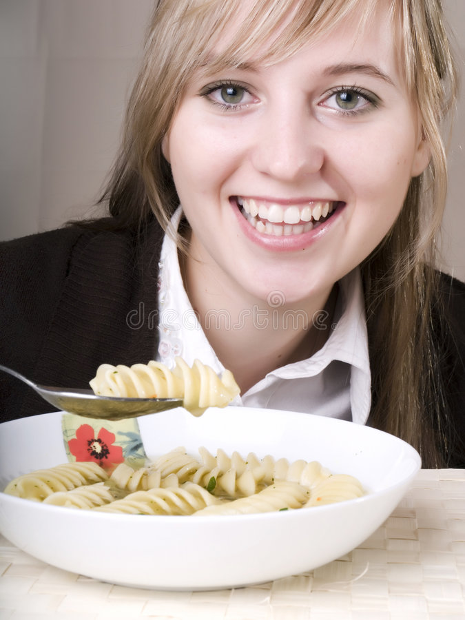 Young woman eating royalty free stock image