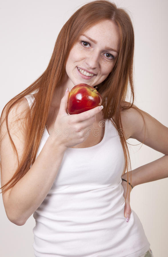 Download Young Woman Eating An Apple Stock Photo - Image: 25034390