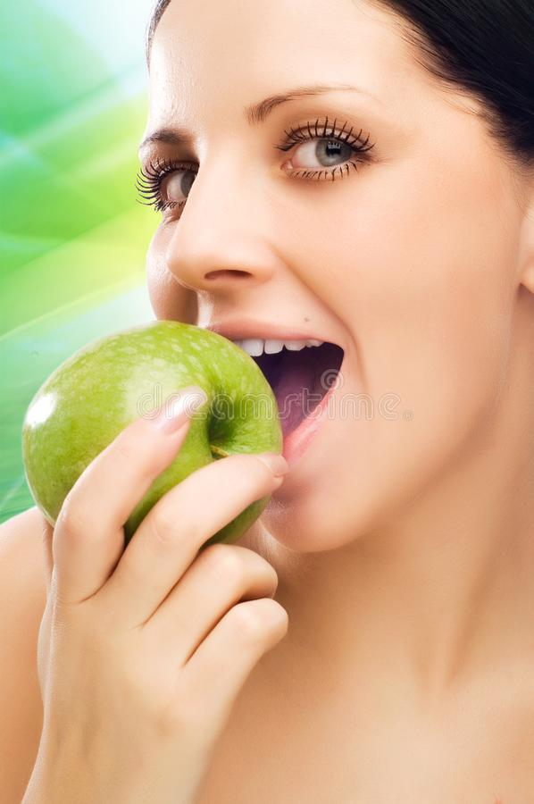 Download Young woman eating apple stock image. Image of happy, caucasian - 9597057