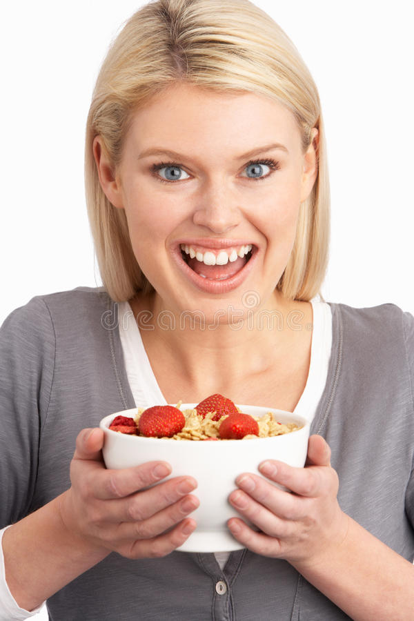 Download Young Woman Eating Bowl Of Healthy Breakfast Stock Image - Image: 14451869