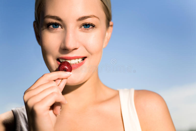 Download Young woman eating cherry stock photo. Image of outdoor - 9644738