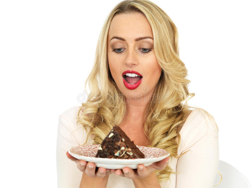 Young Woman Eating Chocolate Cake stock images