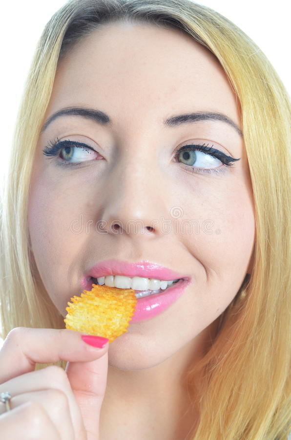 Young woman eating crisps royalty free stock image