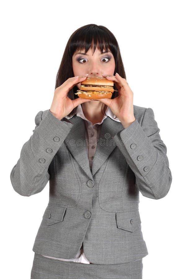 Young woman eating hamburger. Young woman eating a delicious hamburger stock photos