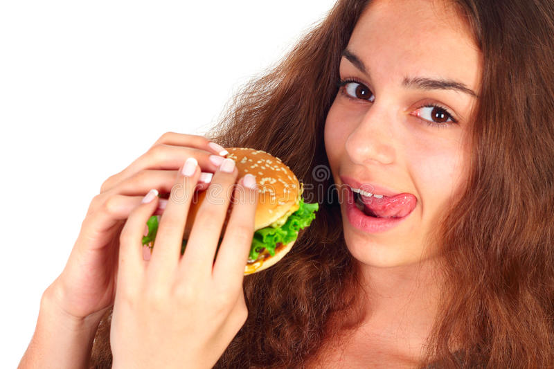 Young woman eating hamburger stock images