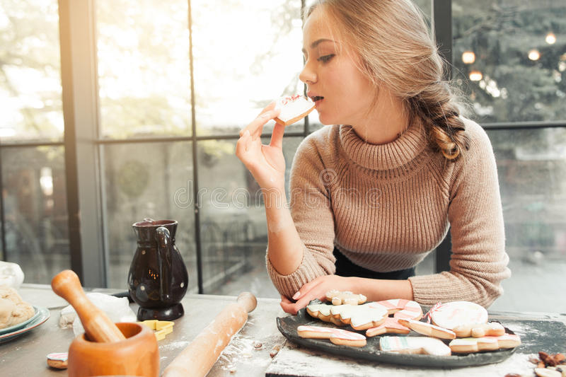 Young woman eating heart cookie free space stock photography