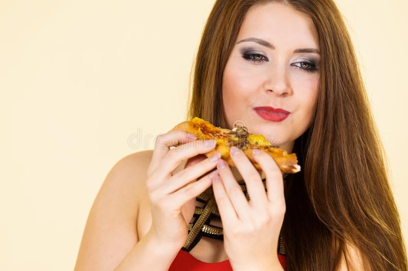 Woman eating hot pizza slice stock photos