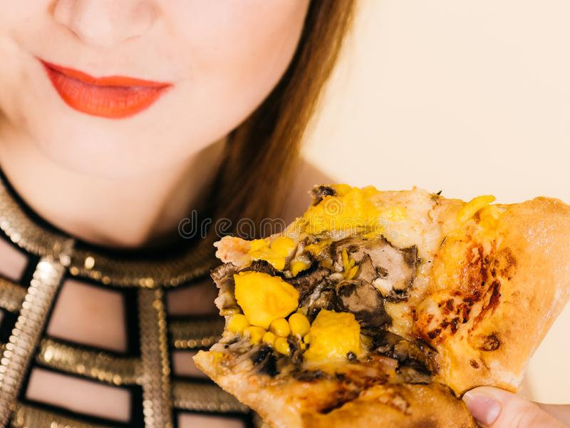 Woman eating hot pizza slice royalty free stock photo