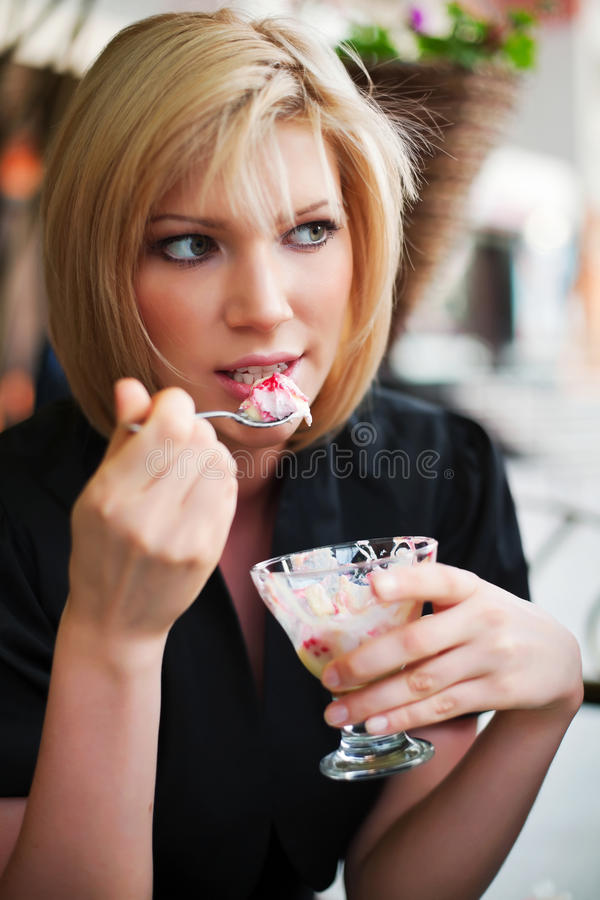 Young woman eating an ice cream stock image