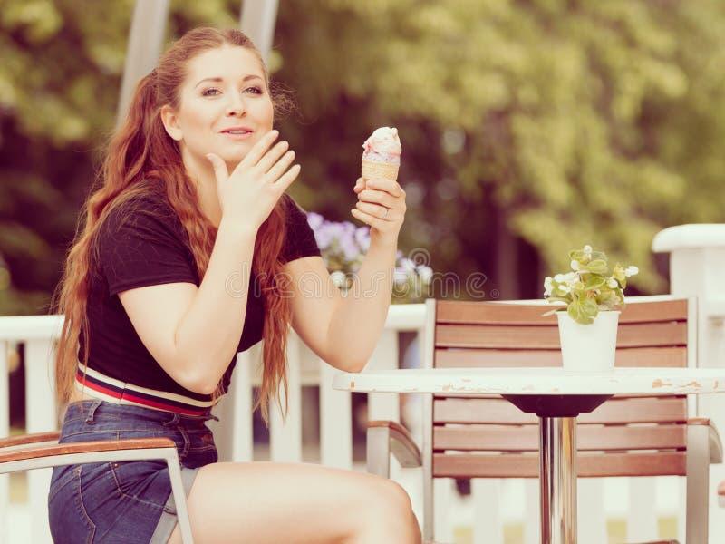 Young woman eating ice cream stock photos