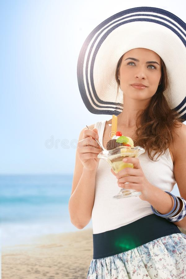 Download Young Woman Eating Icecream On Summer Beach Stock Photo - Image: 19103006