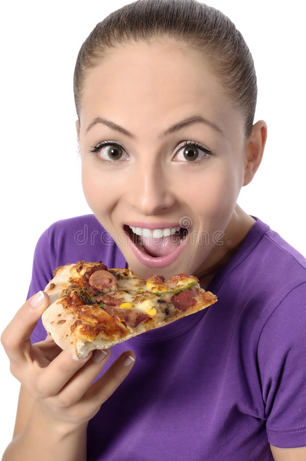 Young woman eating pizza royalty free stock photos