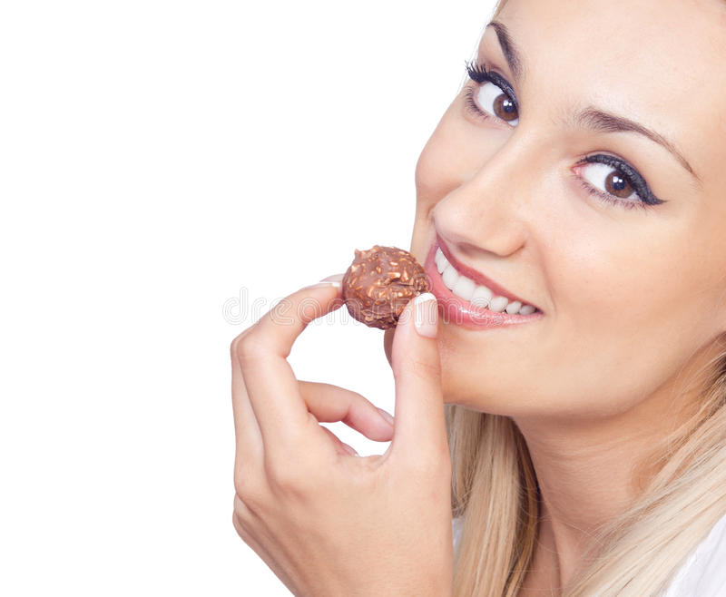 Download Young woman eating praline stock photo. Image of young - 25989962